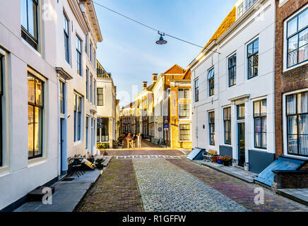 Sunset over the typical Narrow Streets in the Historic City of Middelburg in the Zeeland Province of the Netherlands - Stock Photo