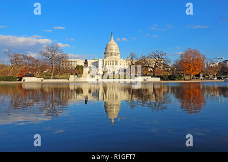The west side of the United States Capitol building and Ulysses S Grant memorial in Washington, DC reflected in the reflecting pool with Christmas tre - Stock Photo