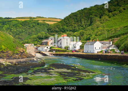 2 July 2018: Boscastle, Cornwall, UK - Visitors stroll around the village in its wooded valley, with the River Valency at low tide. - Stock Photo