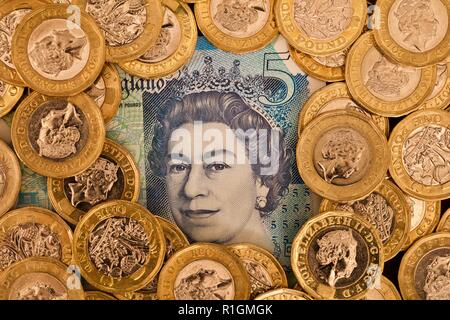 British English currency, coins and banknote, UK sterling - Stock Photo