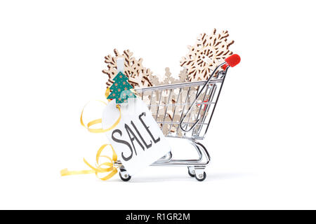 Photo of cart with wooden snowflakes, Christmas tree, postcard, ribbon - Stock Photo