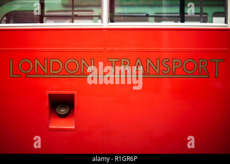 London Transport logo on a vintage bus in the London Bus Museum, Brooklands Museum, Surrey - Stock Photo