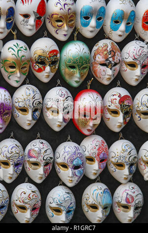 Venice, Italy - July 10, 2011: Many Colorful Venetian Style Masks Souvenirs in Venice, Italy. - Stock Photo