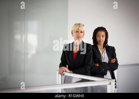 Portrait of two confident businesswomen. - Stock Photo