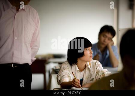 Teenage girl painting in an art room. - Stock Photo