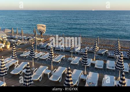 City beach of Nice, sunbeds, umbrellas, Nice, Cote d Azur, France - Stock Photo