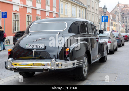 Budapest, Hungary - March 25, 2018: Black old school vintage car ZIS parked in old Budapest city street - Stock Photo