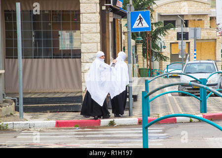 4 December 2018 Young Druze Islamic women in full dress in an Arab community in the Golan Heights Israel. - Stock Photo
