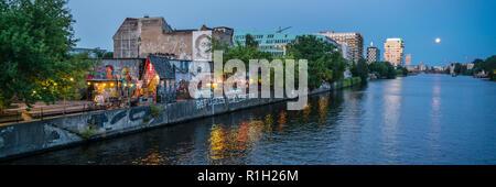Yaam Club at river Spree, Ruins with Graffiti, River Spree, Berlin Friedrichshain - Stock Photo