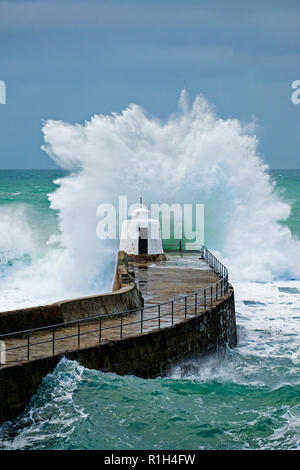 huge atlantic waves from storm barny in 2016 crash againts the breakwater at porteath in cornwall, england, uk. - Stock Photo