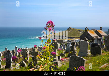 Barnoon cemetery and Porthmeor Beach, looking towards The Island and St Nicholas Chapel, St Ives, Cornwall, England - Stock Photo