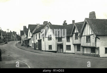 Levernham sudbury suffolk 1947. Lavenham is a village, civil parish and electoral ward in Suffolk, England. It is noted for its Guildhall, Little Hall, 15th-century church, half-timbered medieval cottages and circular walks. In the medieval period it was among the twenty wealthiest settlements in England.[2] Today, it is a popular day-trip destination for people from across the country along with another historic wool town in the area, Long Melford. - Stock Photo