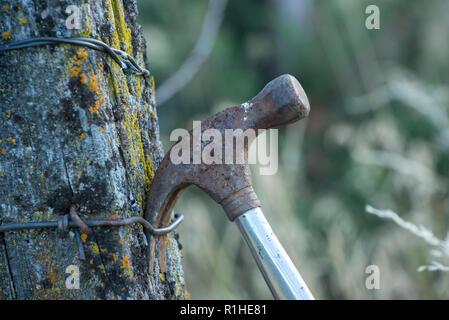 Hammer hanging on fence post, Wallowa Valley, Oregon. - Stock Photo