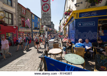 Crowds of people walking on Quay Street, Galway, County Galway, Connacht, Ireland - Stock Photo
