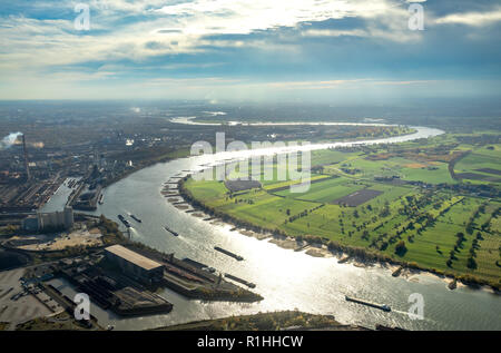 Aerial view, Rhine bend near Duisburg Walsum, Duisburg north, industrial backdrop, Rhine meadows, meadows, fields, river, water reflexes, low tide, Rh - Stock Photo
