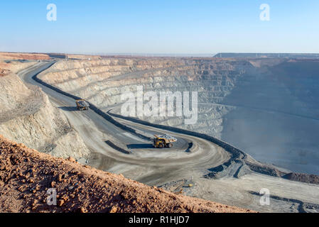 open pit mine in Mongolia, hauling trucks - Stock Photo