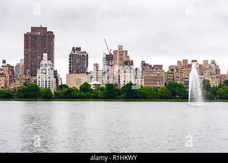 Scenic view of the skyline of New York City from Central Park a misty day of summer - Stock Photo