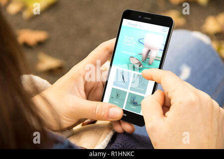 mobile design concept: woman holding a 3d generated smartphone with navigation app on the screen. Graphics on screen are made up. - Stock Photo