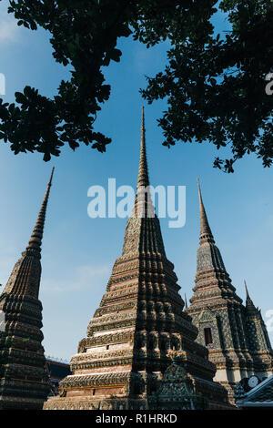 Big ancient pagodas in Was Pho temple. Bangkok, Thailand. - Stock Photo
