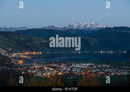 A view on Unterageri and Oberageri villages on the shore of Lake Ageri from the top of Zugerberg mountain in Canton of Zug, Switzerland - Stock Photo