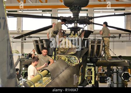 U.S. Soldiers assigned to Company D, 1st Battalion, 3rd Aviation Regiment (Attack Reconnaissance) conduct 500 hours phase maintenance on an AH-64 Apache helicopter at Katterbach Army Airfield, Germany, Sept. 20, 2018. Phase maintenance inspections occur at regular intervals on all aircraft in order to keep them operational. - Stock Photo