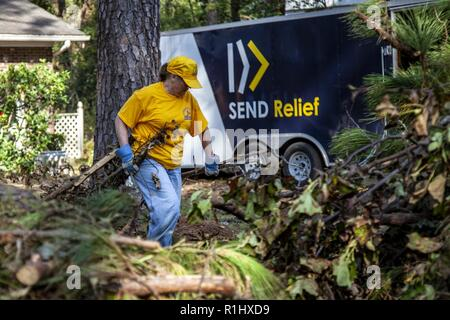Volunteers with Southern Baptist Convention (SBC) Disaster Relief, conducts debris removal in Wilmington, NC, Sept. 21, 2018. SBC Disaster Relief volunteers are helping with residential cleanup to aid homeowners affected by Hurricane Florence. Spc. Tianna S. Isreal/CAISE - Stock Photo