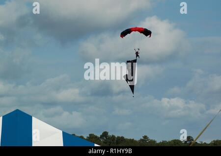 The POW/MIA Flag is flown from a member of the US Army's Black Daggers Parachute Team during the 2018 NAS Oceana Air Show. - Stock Photo