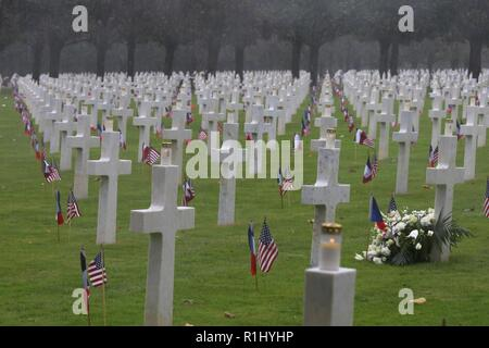 Service members, reenactors and dignitaries from France and the U.S. commemorated the 100th anniversary of the Meuse-Argonne Offensive during a World War I ceremony held at the Meuse-Argonne American Cemetery in France, Sept. 23, 2018. Thunderstorms and gale-force winds did not prevent crowds from honoring those who sacrificed all for peace. - Stock Photo
