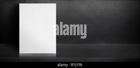 Blank white poster leaning at black interior cement room background,mock up banner template for display of design,leave side space for adding text for - Stock Photo
