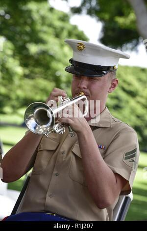 A member from the Marine Corps Forces Pacific Band plays music during the National POW/MIA Recognition Day ceremony hosted by the Defense POW/MIA Accounting Agency at the National Memorial Cemetery of the Pacific, Honolulu, Hawaii, Sept. 21, 2018. This day was first established in 1979 through a proclamation from President Jimmy Carter, in observance to honor and recognize the sacrifices of those Americans who have been prisoners of war and to remind the nation of those who are still missing in action. The event is held every year on the third Friday of September in honor of those who were pri - Stock Photo
