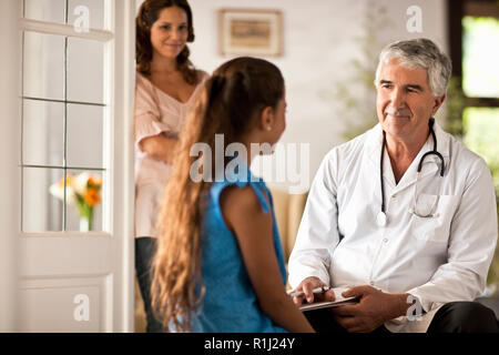 Young girl getting a checkup at the doctor's office. - Stock Photo