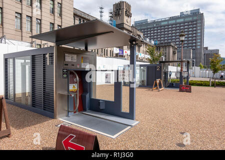 Entrance booth of a Giken Eco Cycle automated underground bicycle parking in front of Kyoto City Hall, Japan. - Stock Photo
