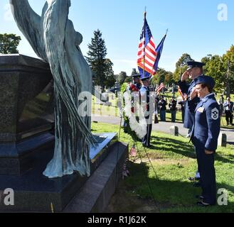New York Air National Guard Brig. Gen. Timothy J. LaBarge, the NewYork National Guard Director of Joint Staff, and Command Chief Master Sgt. Maureen Dooley, the senior ranking noncommissioned officer for the New York Air National Guard, present a wreath from President Donald Trump at the gravesite of President Chester A. Arthur in Albany Rural Cemetery in Menands, N.Y. on October 5, 2018. Representatives of the United States Armed Forces present a wreath from the current president at the gravesite of past presidents on their birthdays. Arthur, the 21st President of the United States, was born  - Stock Photo