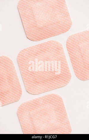 top view of adhesive bandages on white surface - Stock Photo
