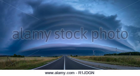 Panorama of a shelf cloud during an approaching thunderstorm in the blue hour on June 24th 2016, Grimmen, Mecklenburg-Vorpommern, Germany - Stock Photo