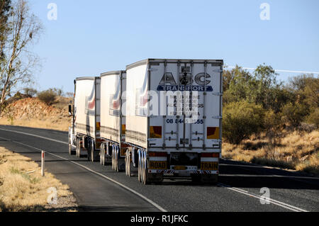 A road train weighing  over 150 tonnes making its way along the Stuart Highway from Alice Springs to Darwin in the  Northern Territorty. Australia. - Stock Photo