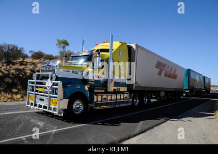 A road train heading north to Darwin from Alice Springs on the stuart Highway, Northern Territorty. Australia. - Stock Photo