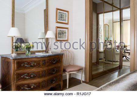 Wooden drawers in bedroom - Stock Photo