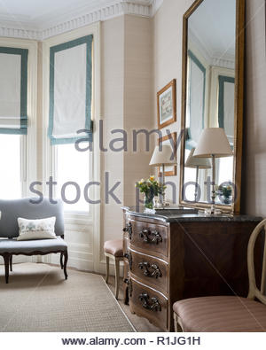 Wooden drawers in country style bedroom - Stock Photo