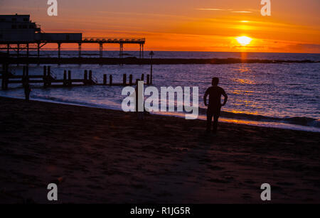 Aberystwyth, Ceredigion, West Wales, UK 23rd February 2016.  UK Weather: People come out to play and enjoy the gorgeous sunset after a magnificent day - Stock Photo