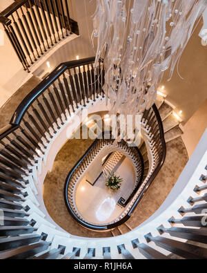 View above spiral staircase with pendant light - Stock Photo