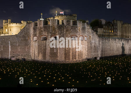 London, UK - November 6th 2018: Beyond The Deepening Shadow at the Tower of London - an installation of 10,000 flames to commemorate the end of the Fi - Stock Photo