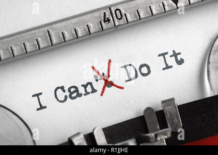 Can't crossed out to read I can do it concept for self belief, positive attitude and  motivation written on an old typewriter - Stock Photo