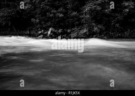 River flows, long exposure selective focus, black and white image taken at the Vidima river in Northern Bulgaria - Stock Photo