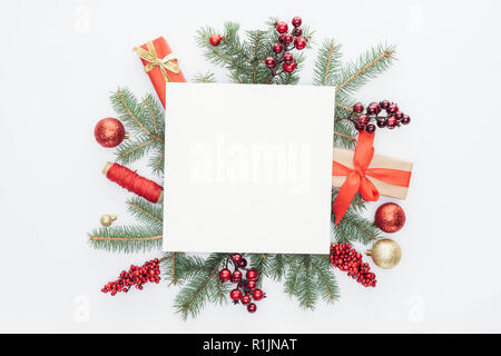 top view of pine tree branches, christmas decorations and gifts with square blank space in middle isolated on white - Stock Photo