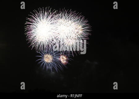Fireworks exploding during a Fireworks Festival, Tokyo, Japan - Stock Photo