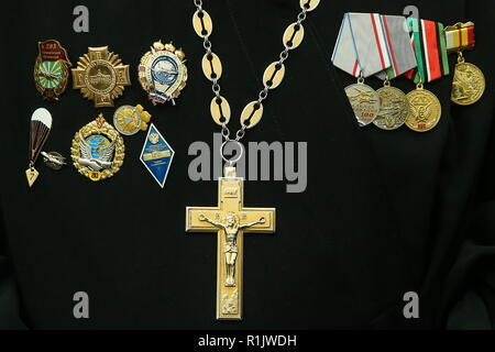 Ryazan, Russia. 13th Nov, 2018. RYAZAN, RUSSIA - NOVEMBER 13, 2018: A priest wears an Orthodox crucifix and military decorations in the Church of St George the Great Martyr during festive events held at the Ryazan Higher Airborne Command School to celebrate its 100th birthday. Alexander Ryumin/TASS Credit: ITAR-TASS News Agency/Alamy Live News - Stock Photo