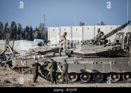 Israel. 13th Nov, 2018. Israeli soldiers seen with Merkava battle tanks along the Israeli-Gaza border. According to Israeli army spokesman, Palestinian militants has launched nearly 400 rockets and mortar shells from the Gaza Strip into Israel, who has later responded by airstrikes on more than 100 military targets in response. Credit: Ilia Yefimovich/dpa/Alamy Live News - Stock Photo