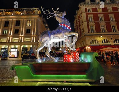 Covent Garden Market, London, UK. 13th November 2018. Christmas lights and decorations shaped like baubles and mistletoe switched on in London, UK Credit: Paul Brown/Alamy Live News - Stock Photo