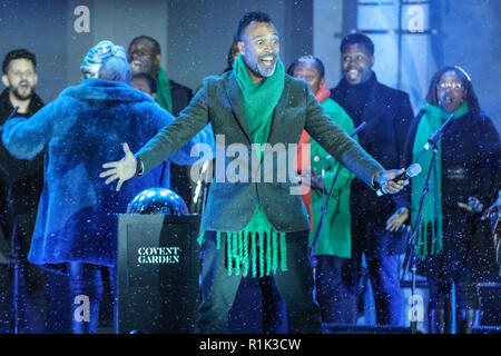 Covent Garden, London, UK, 13th Nov 2018. The Kingdom Choir sing. Paloma Faith switches on the Covent Garden Christmas lights in the iconic Piazza, while The Kingdom Choir and the company of RSC's Matilda The Musical entertained the crowd. Credit: Imageplotter News and Sports/Alamy Live News - Stock Photo